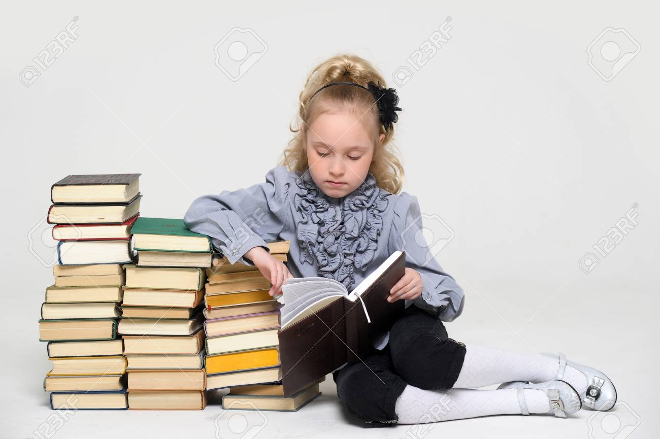 girl schoolgirl with a stack of books Stock Photo - 16220446