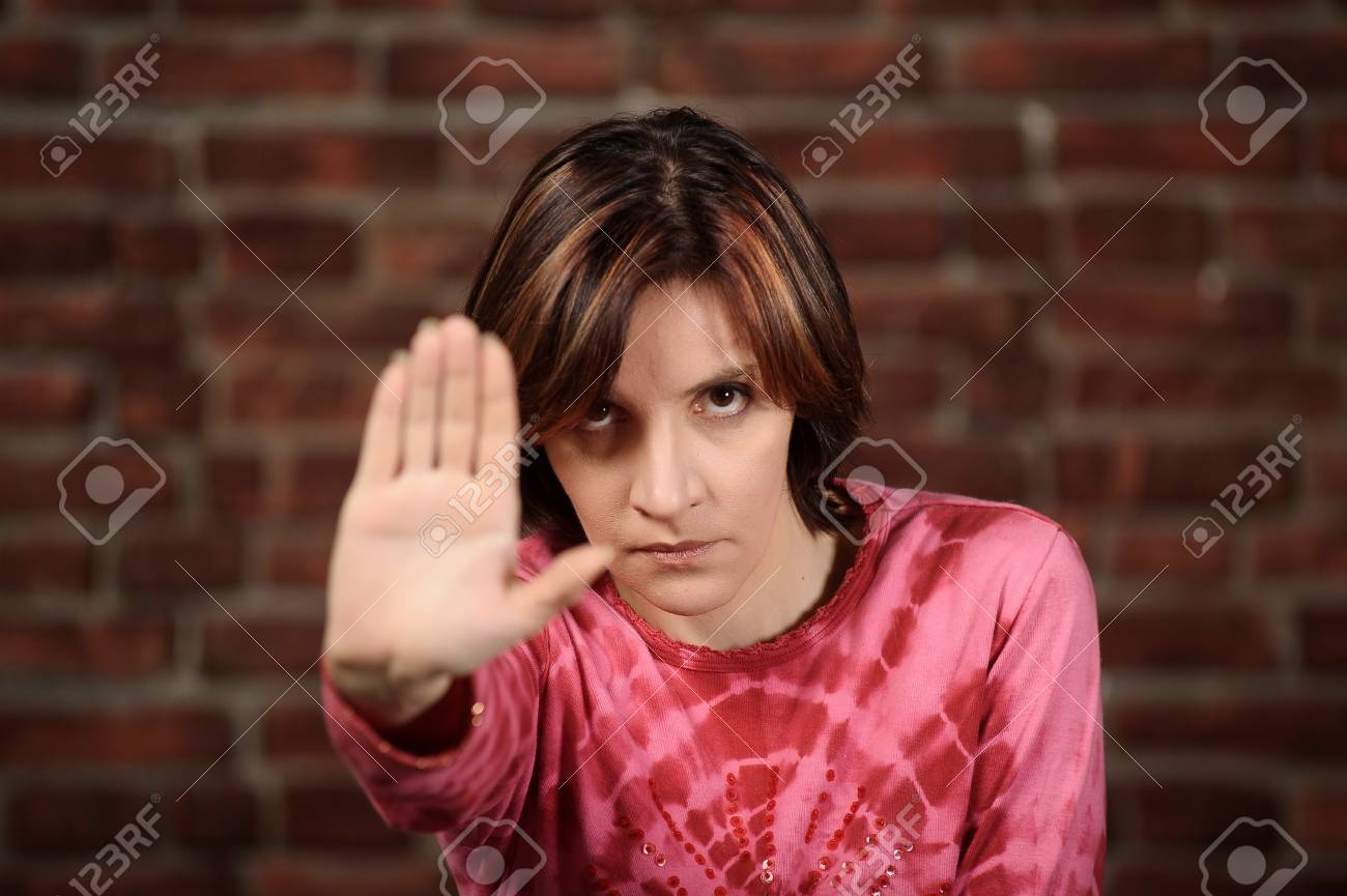 Woman showing stop gesture Stock Photo - 16219747