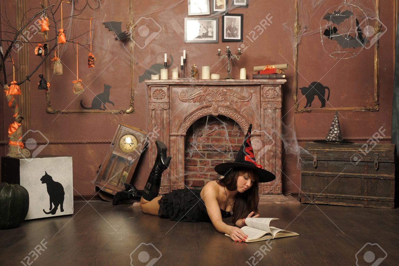 Witch Next To The Fireplace Stock Photo, Picture And Royalty Free ...