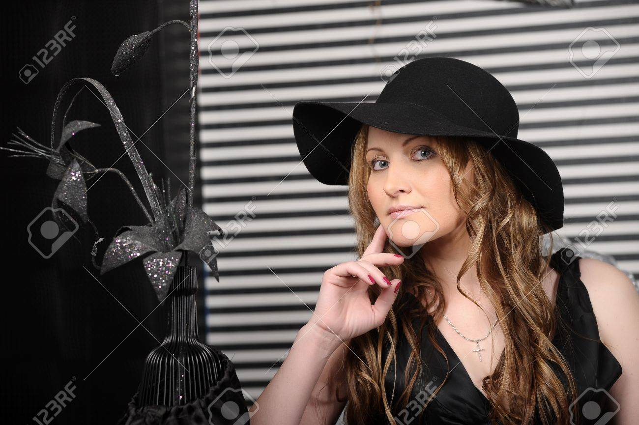 woman in black dress and black hat Stock Photo - 17927228