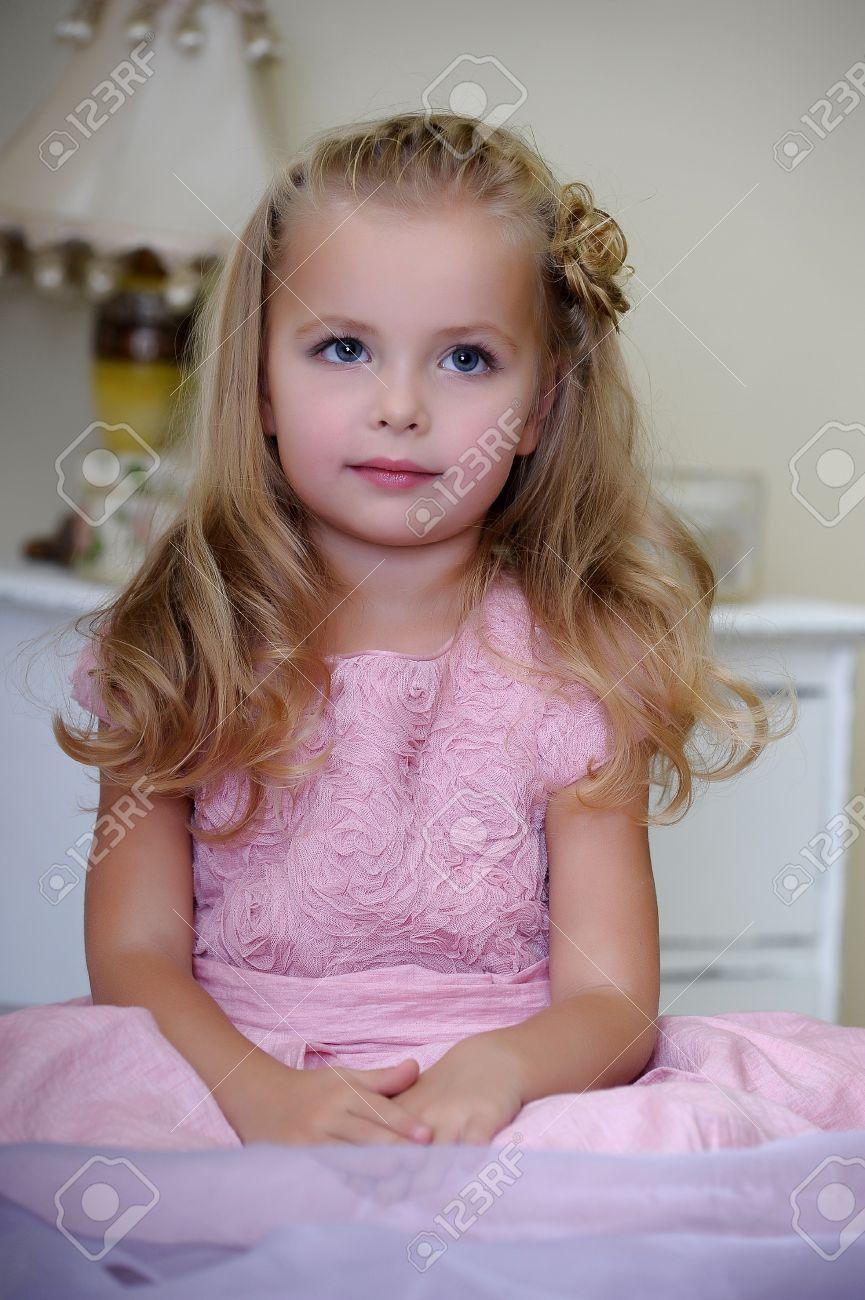 blonde little girl Beautiful little girl pink dress Stock Photo - 16791055