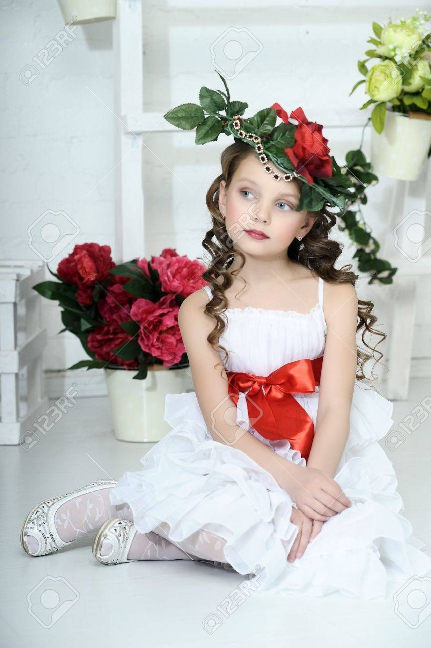 Vintage Girl with Flowers in her hair Stock Photo - 17458336