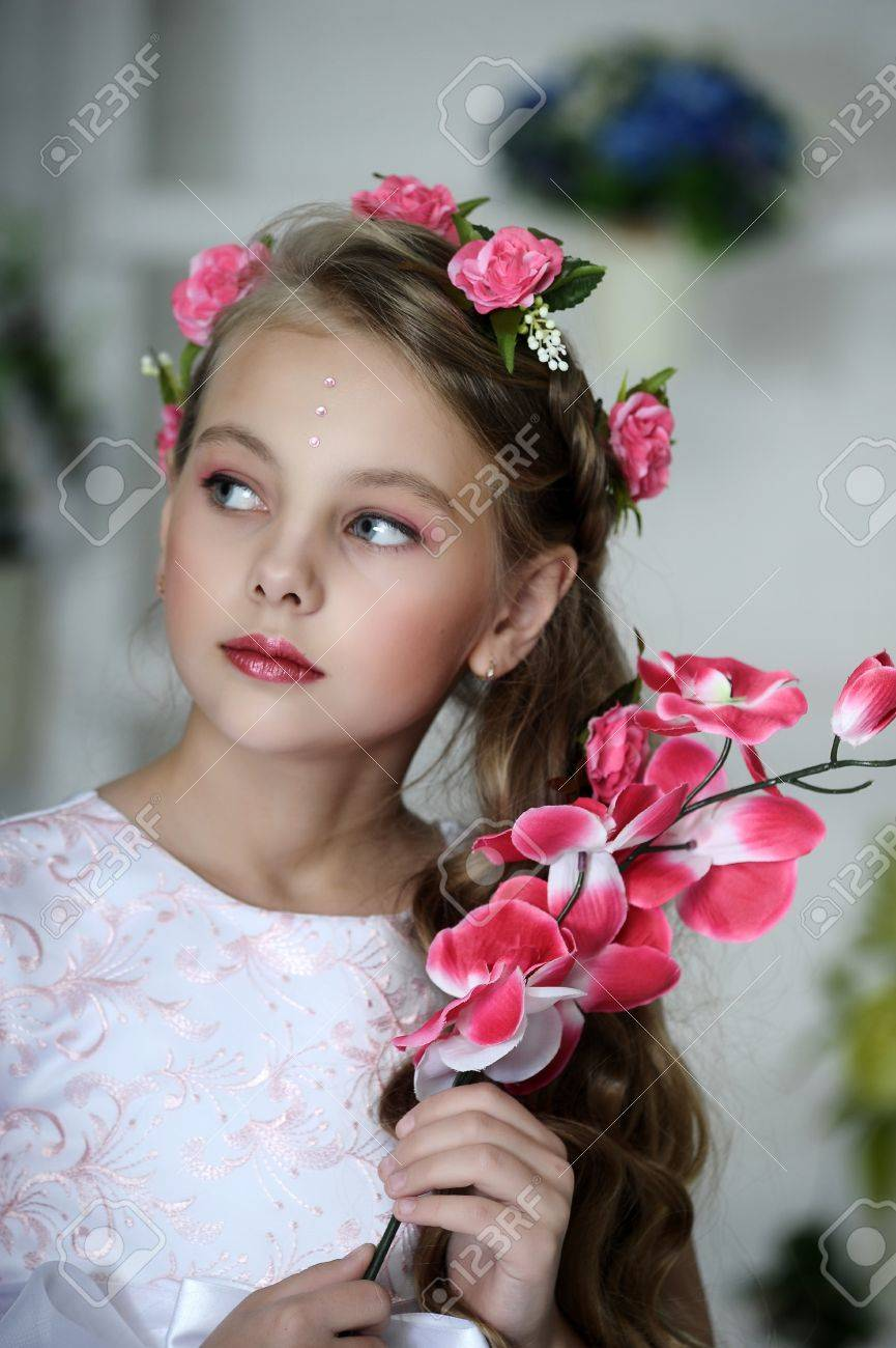 Vintage Girl with Flowers Stock Photo - 17458357
