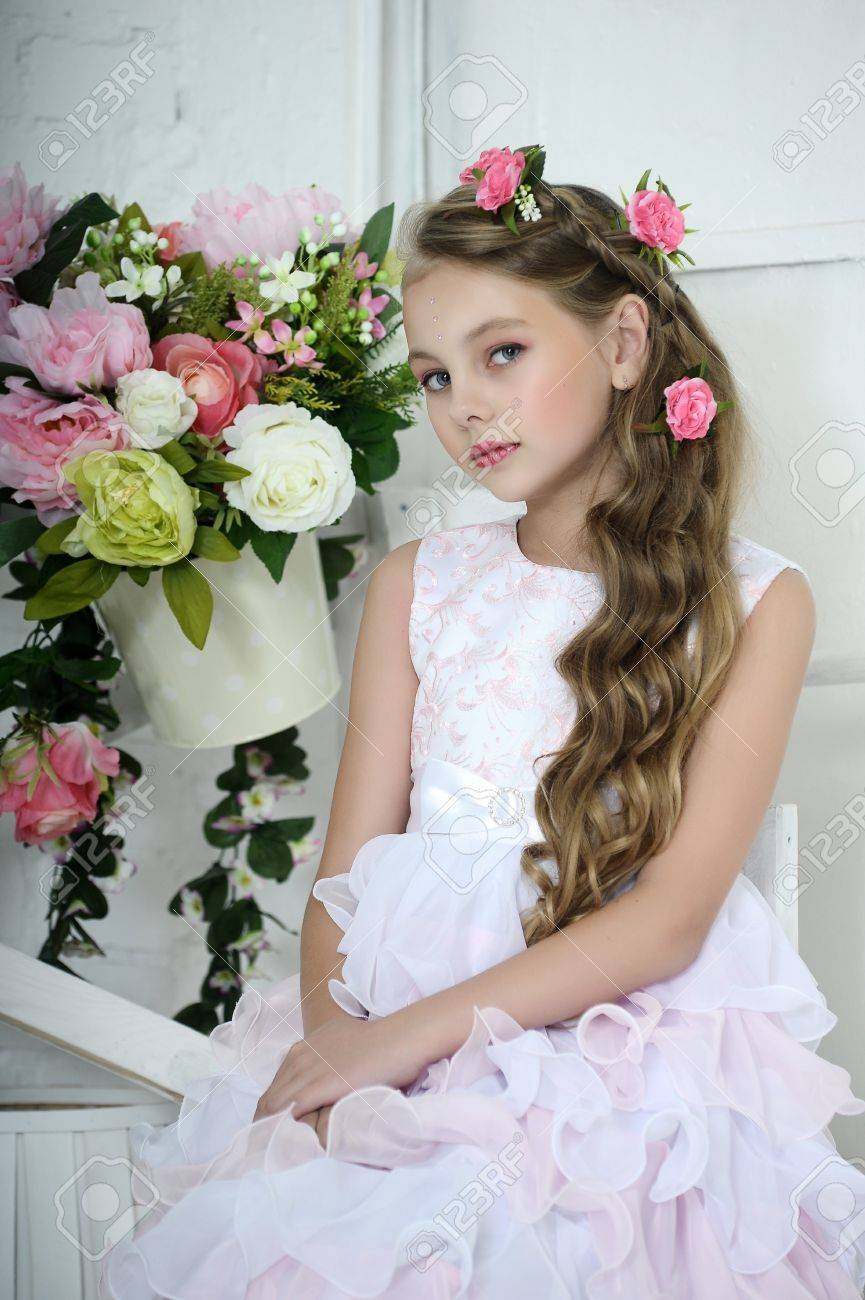 Vintage Girl with Flowers Stock Photo - 17458345