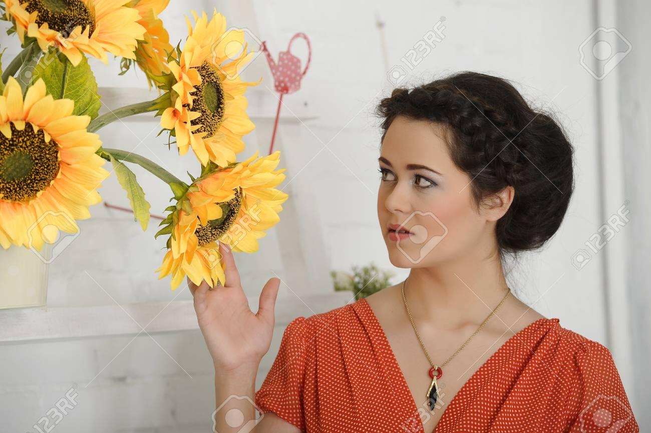 beautiful young brunette sunflowers Stock Photo - 17458329