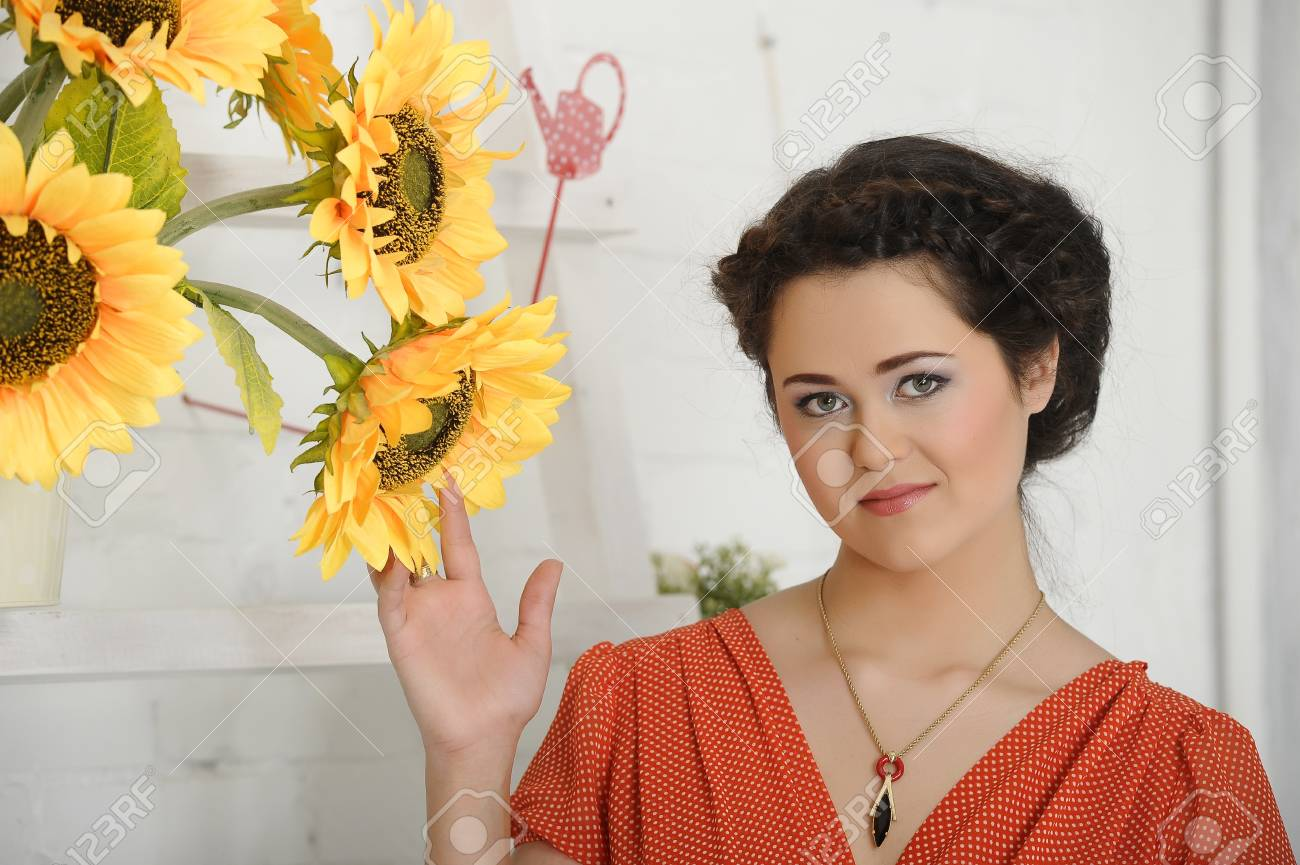 beautiful young brunette sunflowers Stock Photo - 17458328