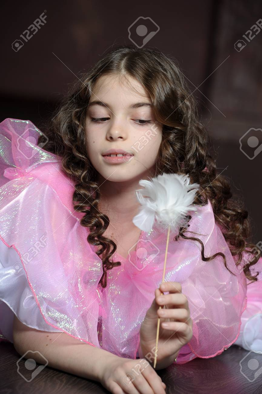 girl with dark curly hair in a pink dress Stock Photo - 17269928