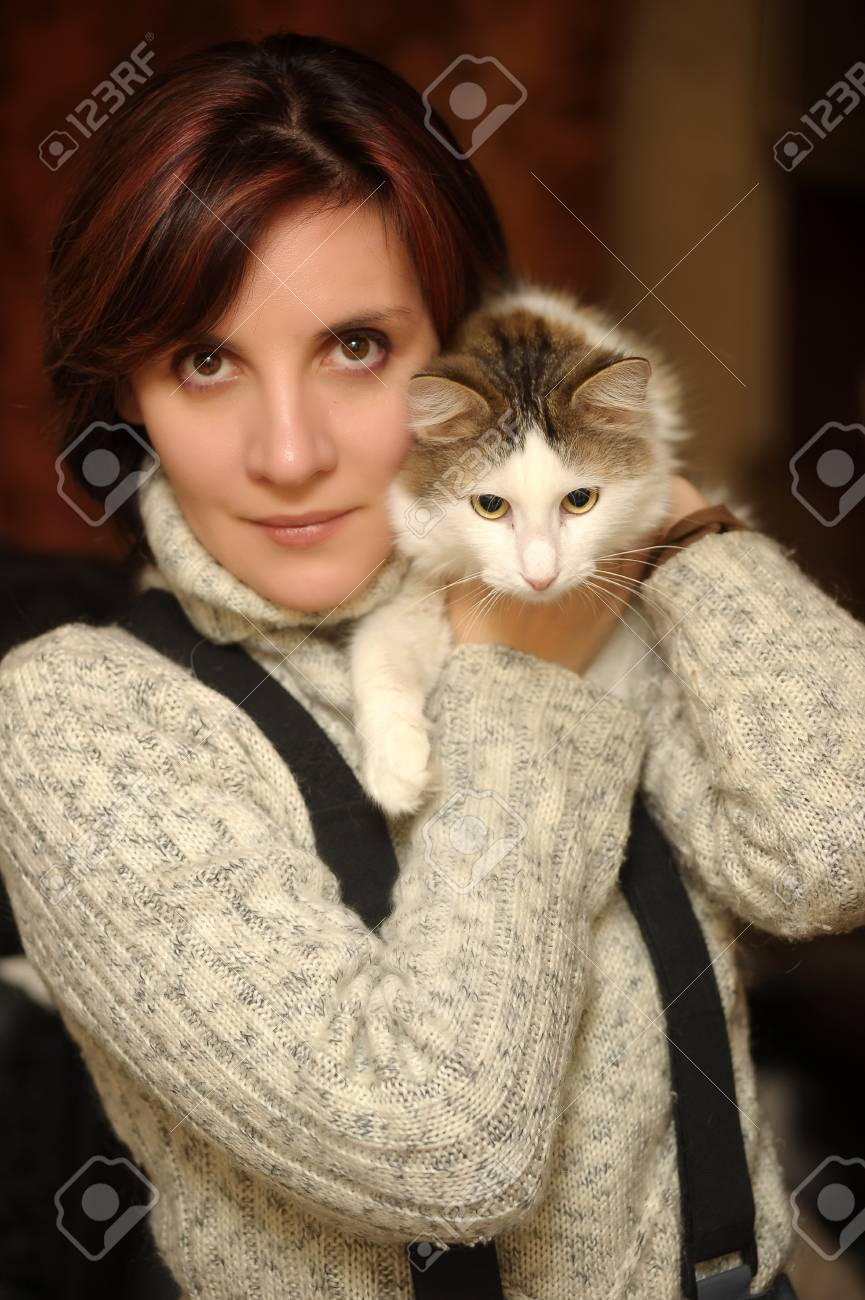 Young woman with a cat in her arms Stock Photo - 17268337