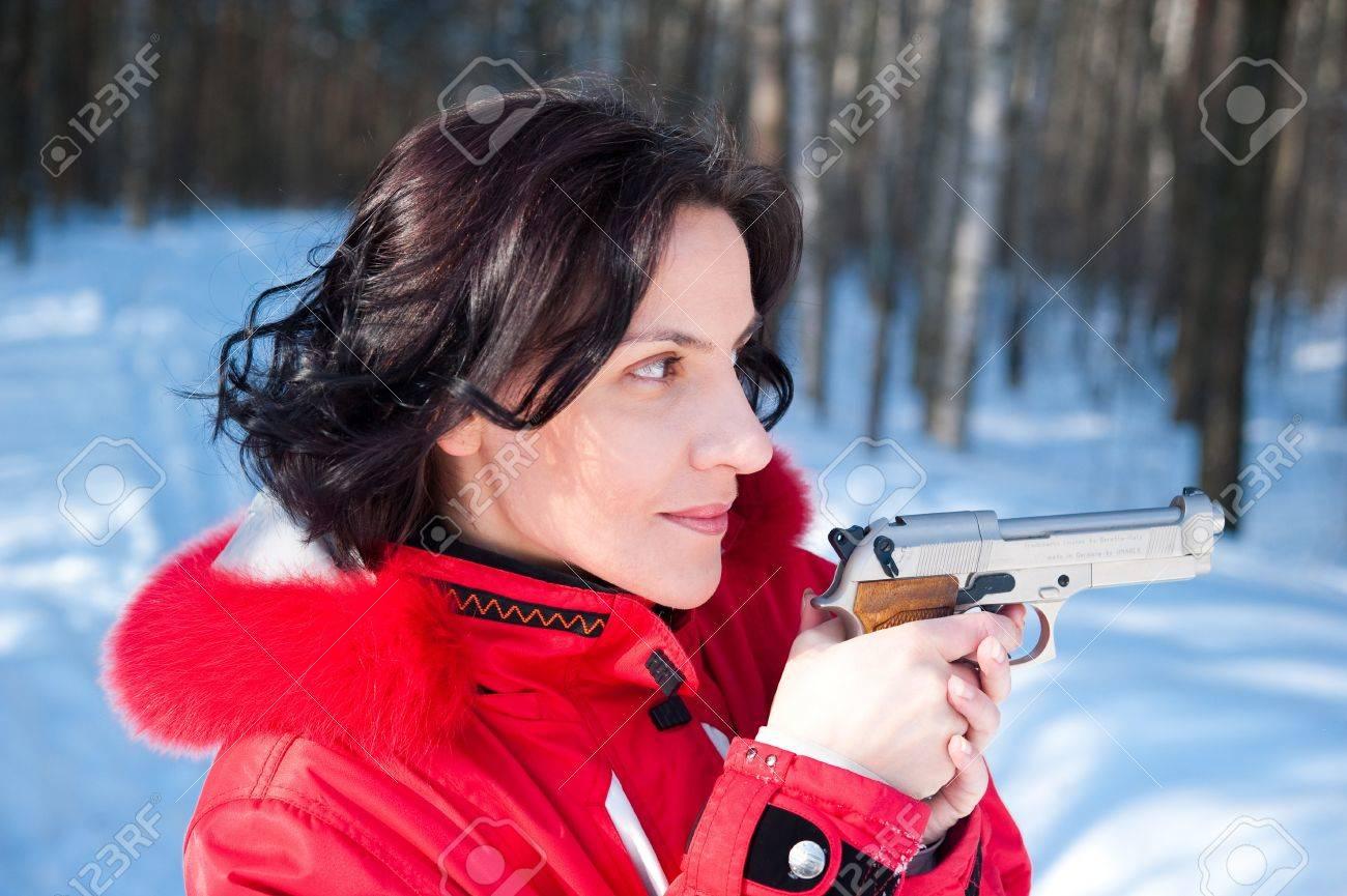 Winter girl with gun Stock Photo - 17268439
