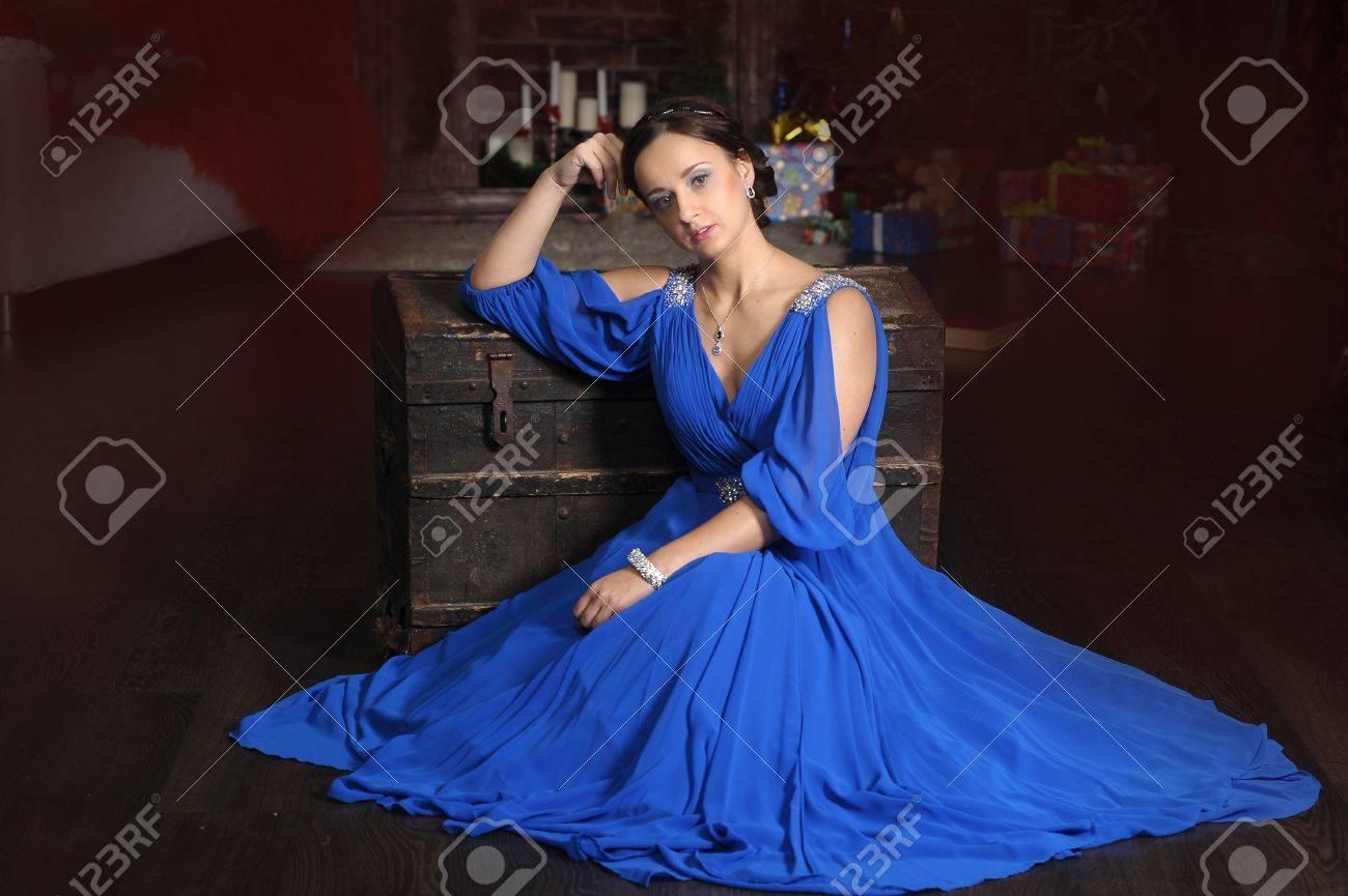 d16a7e7ca071 Elegant Woman In Retro Style In A Blue Dress Stock Photo, Picture ...