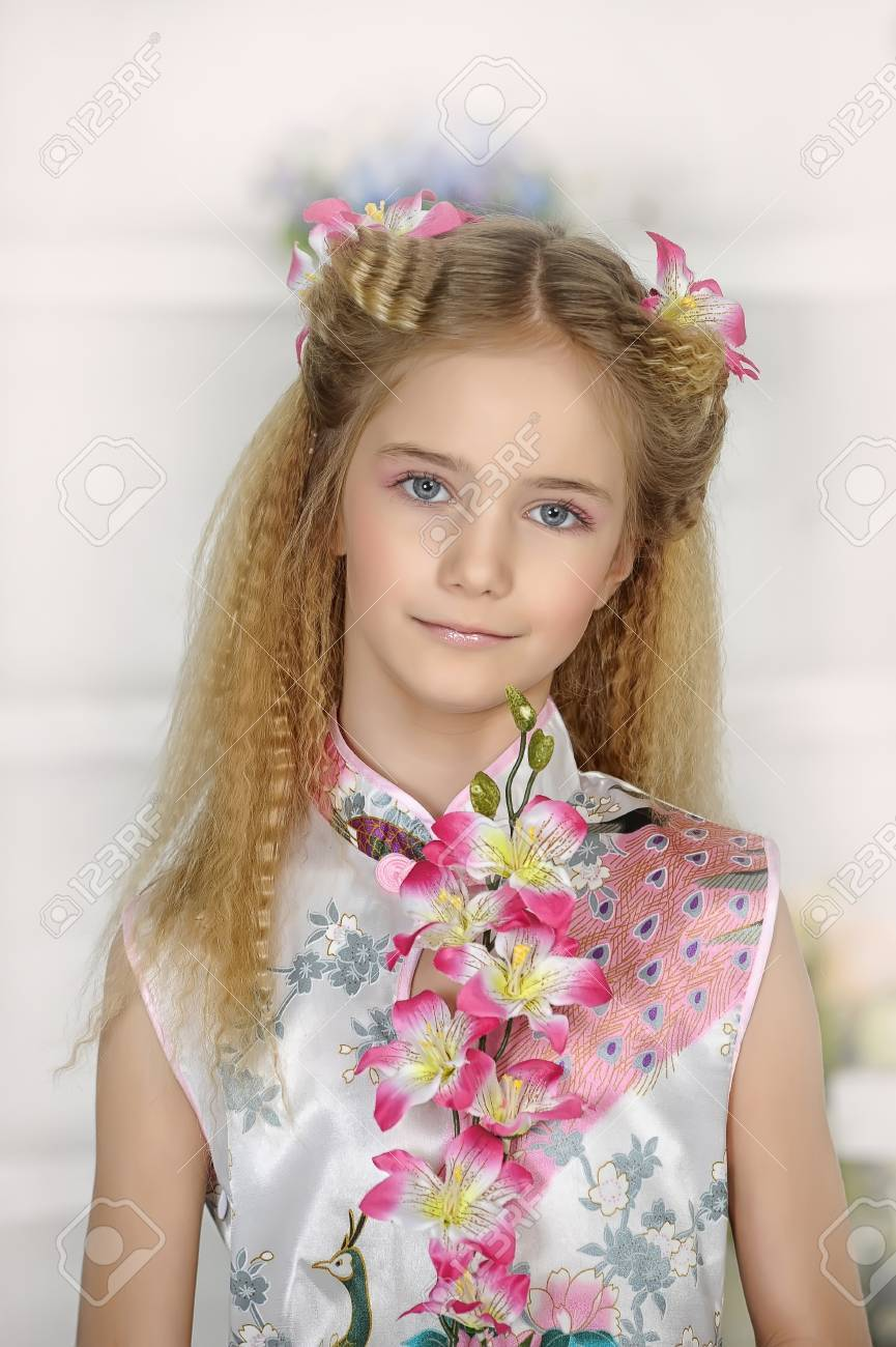 girl with pink flowers in her hair Stock Photo - 19023735