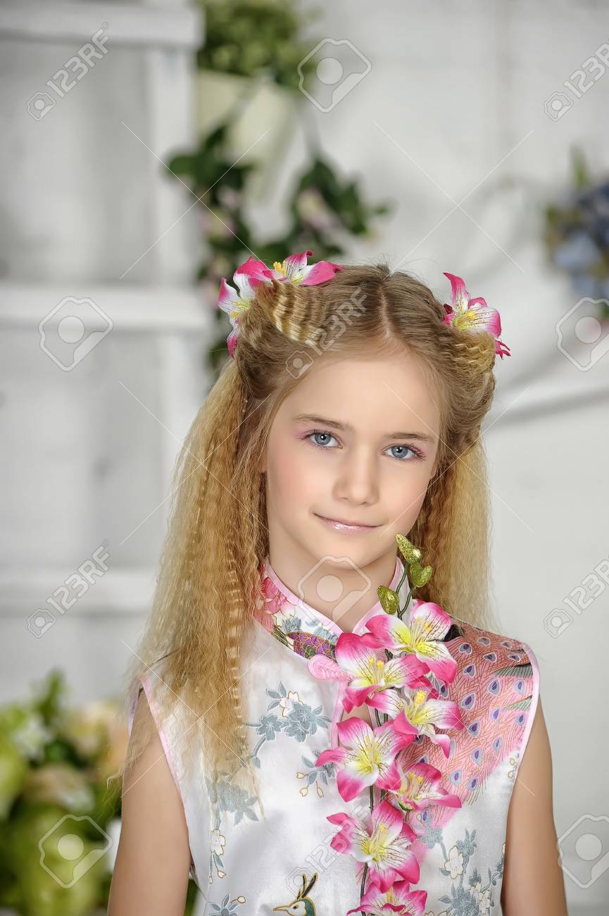girl with pink flowers in her hair Stock Photo - 19023733
