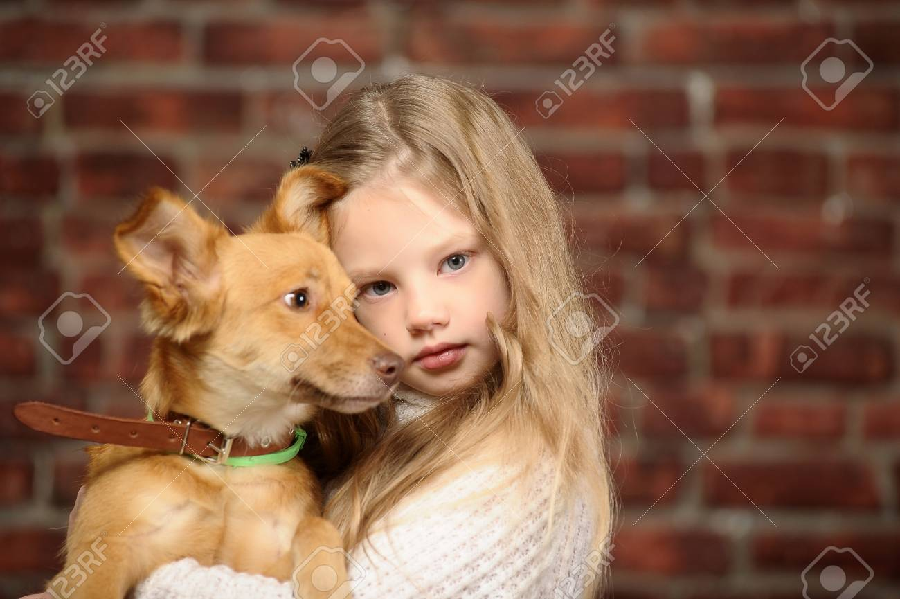 girl with red puppy Stock Photo - 17787490