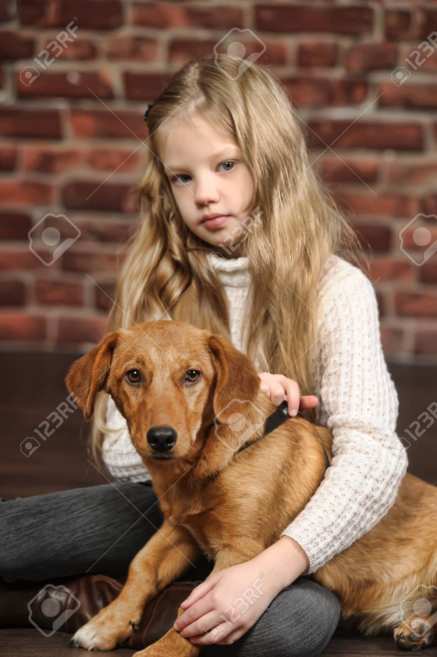 girl with red puppy Stock Photo - 17787488