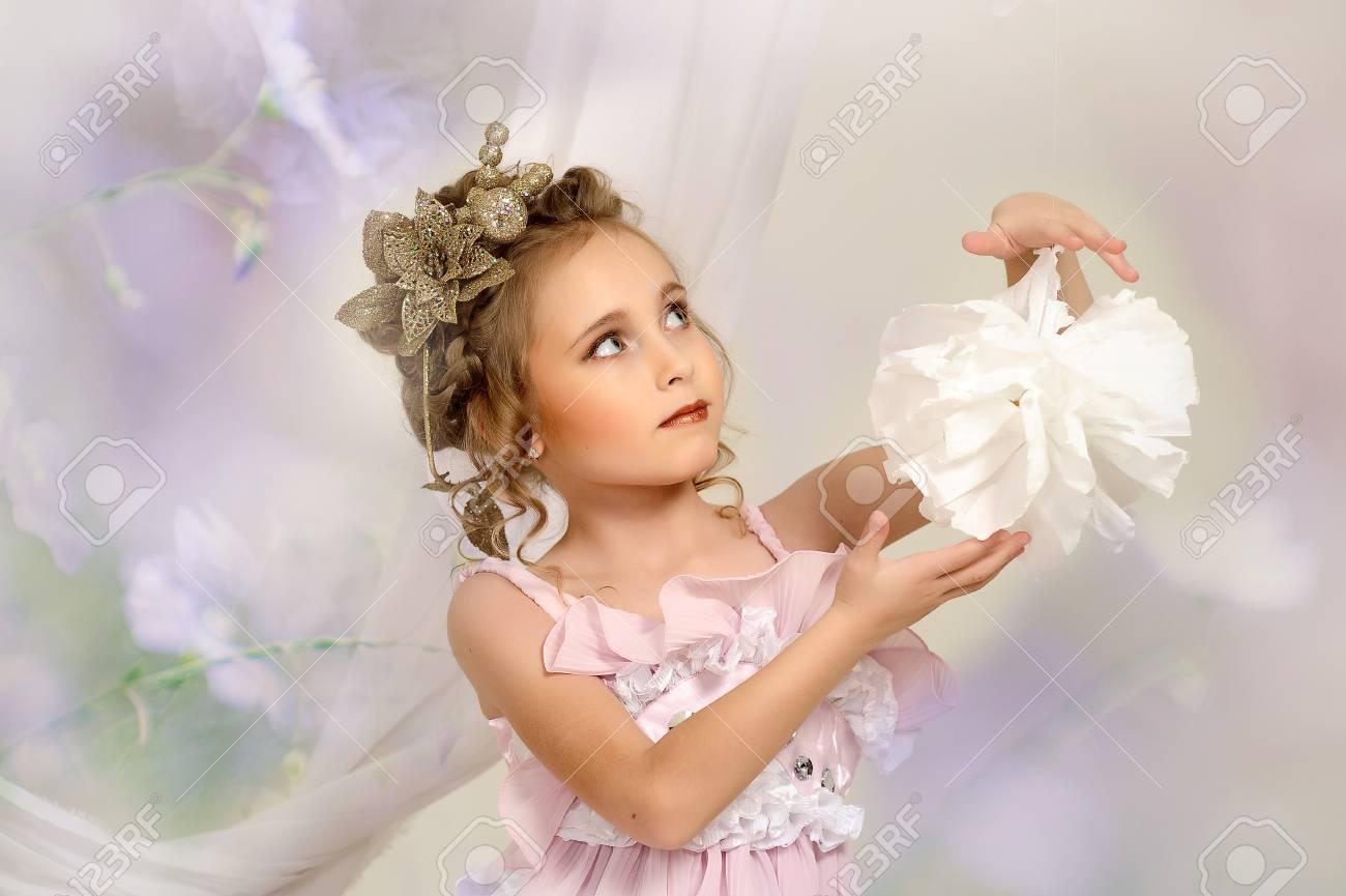 flirting little girl pink dress Stock Photo - 18592439