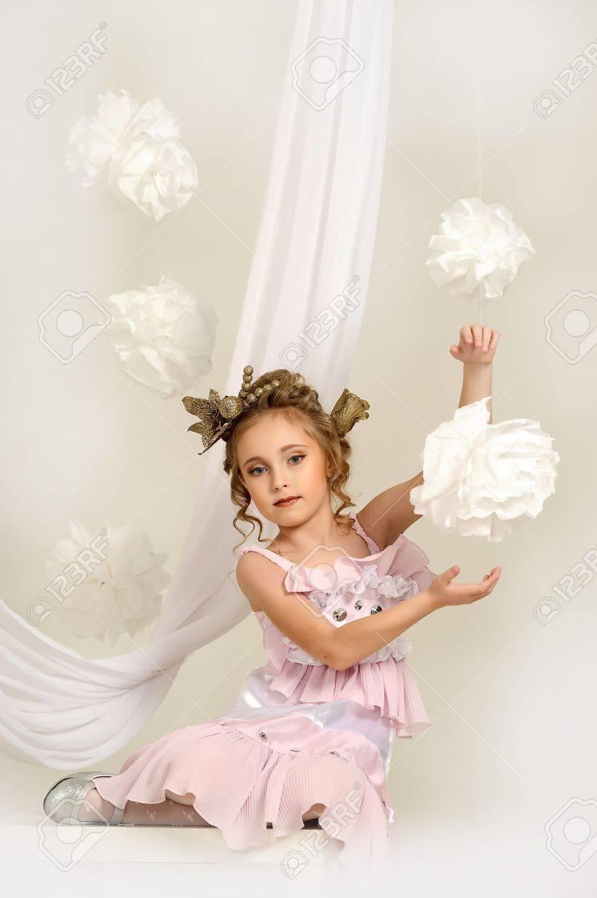 flirting little girl pink dress Stock Photo - 18592411