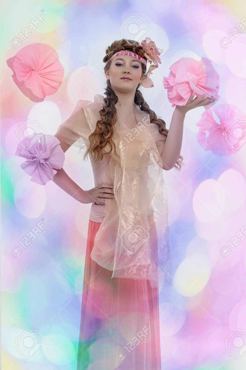 beautiful girl in pink with a flower in her hair Stock Photo - 17976050