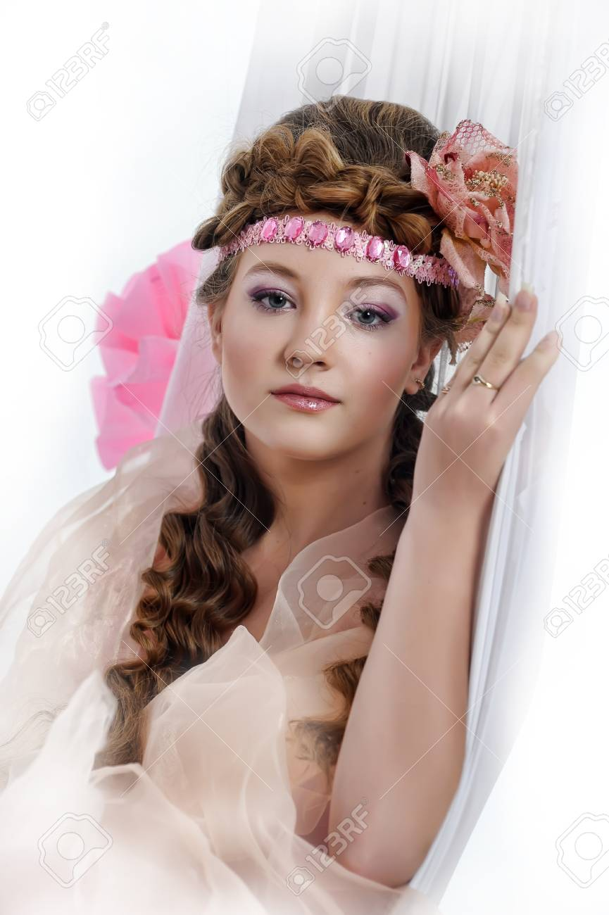 beautiful girl in pink with a flower in her hair Stock Photo - 17976060