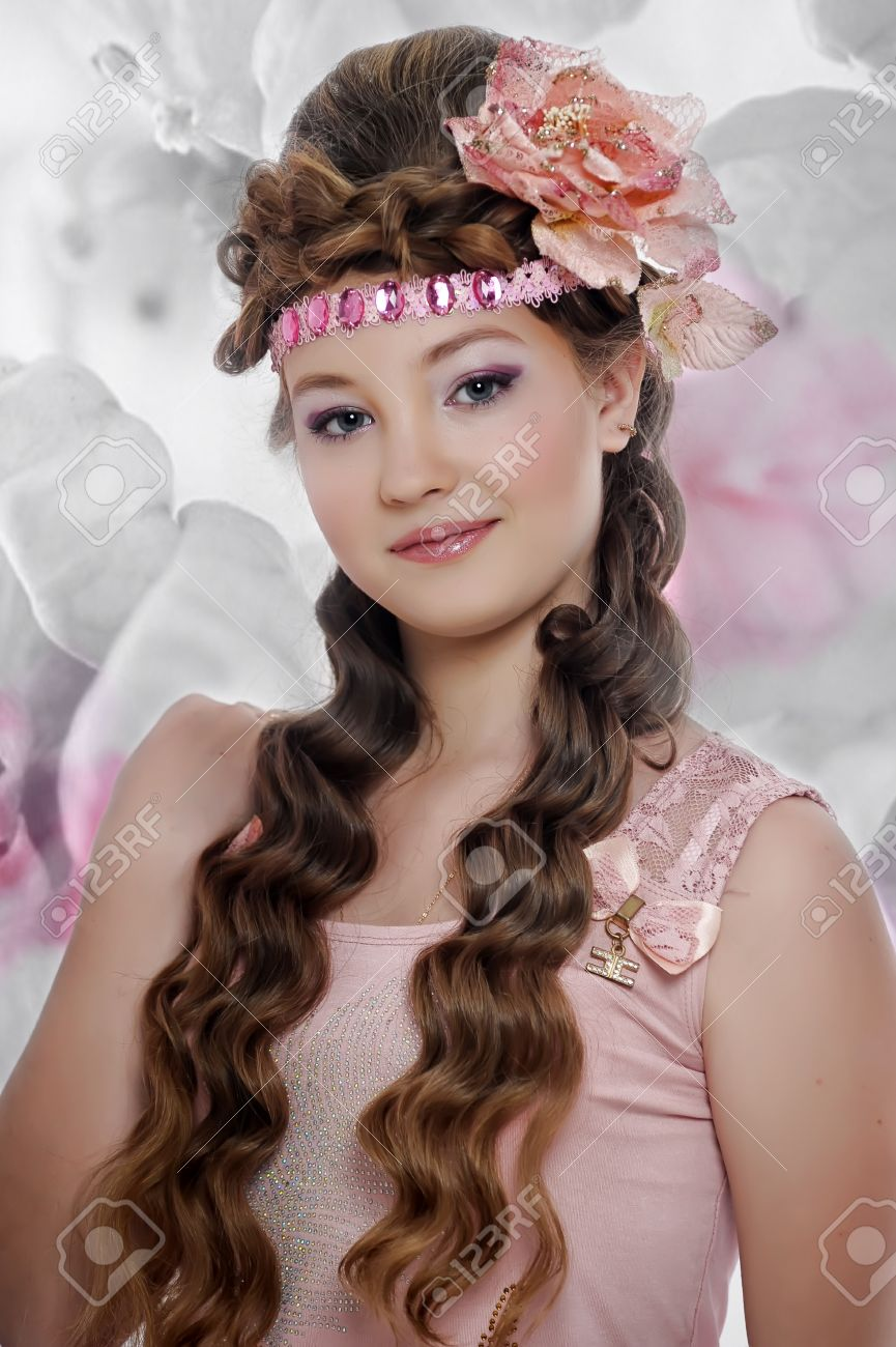 beautiful girl in pink with a flower in her hair Stock Photo - 17976075