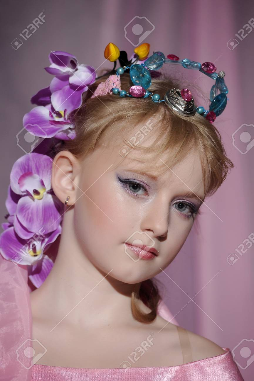 portrait of girl with orchids in her hair and a crown Stock Photo - 18850515