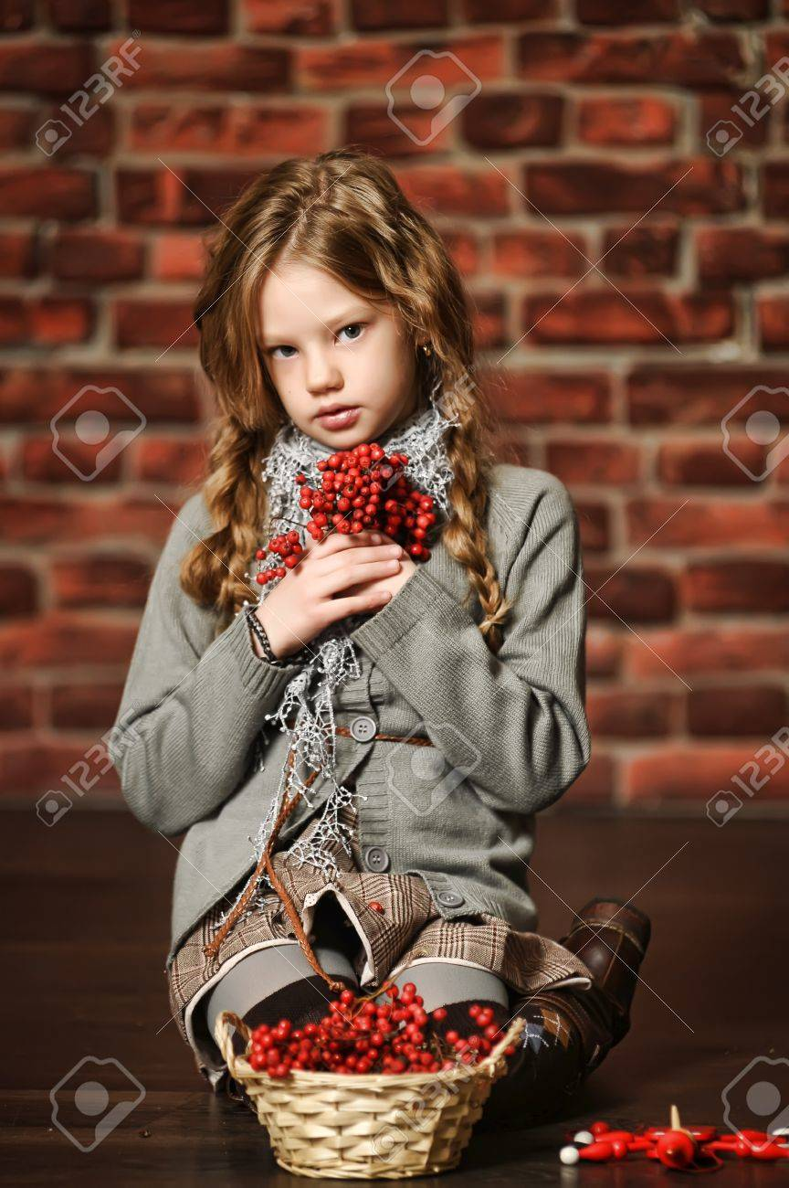 portrait of a girl with a mountain ash in the hands Stock Photo - 19350832