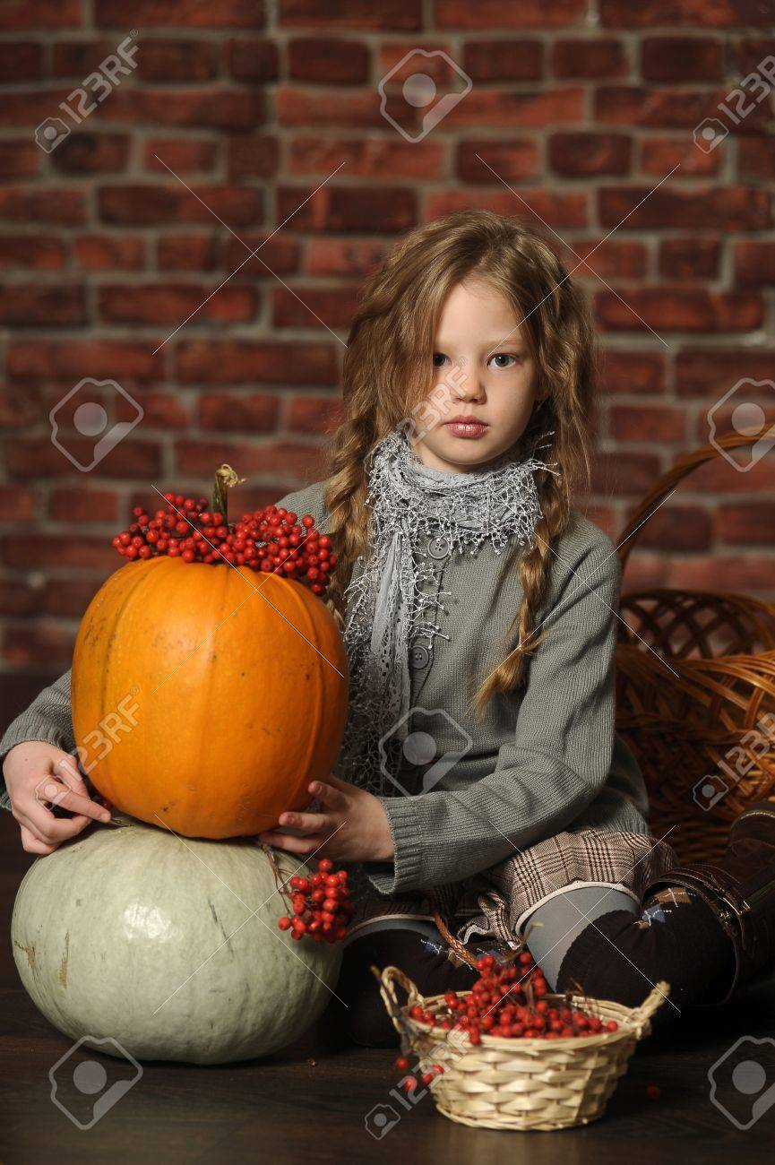 Autumn portrait of a girl with a pumpkin Stock Photo - 18207239