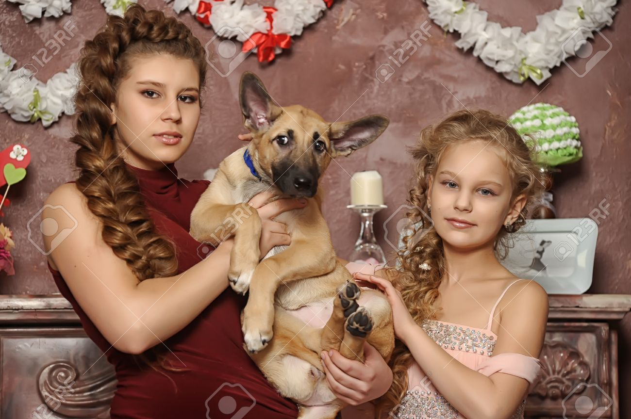 two sisters with a puppy Stock Photo - 17935847