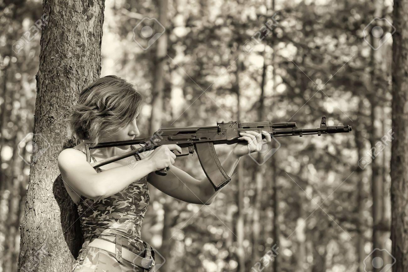 woman with a gun Stock Photo - 17988540