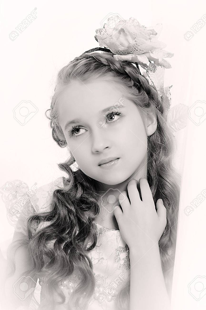 Retro style girl with a flower in the curls Stock Photo - 21076713