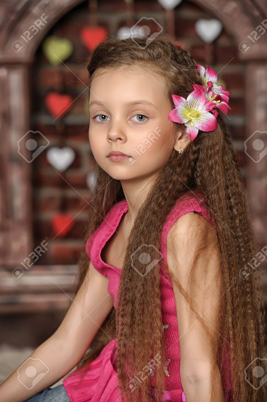 little girl with pink flowers in her hair Stock Photo - 21076790