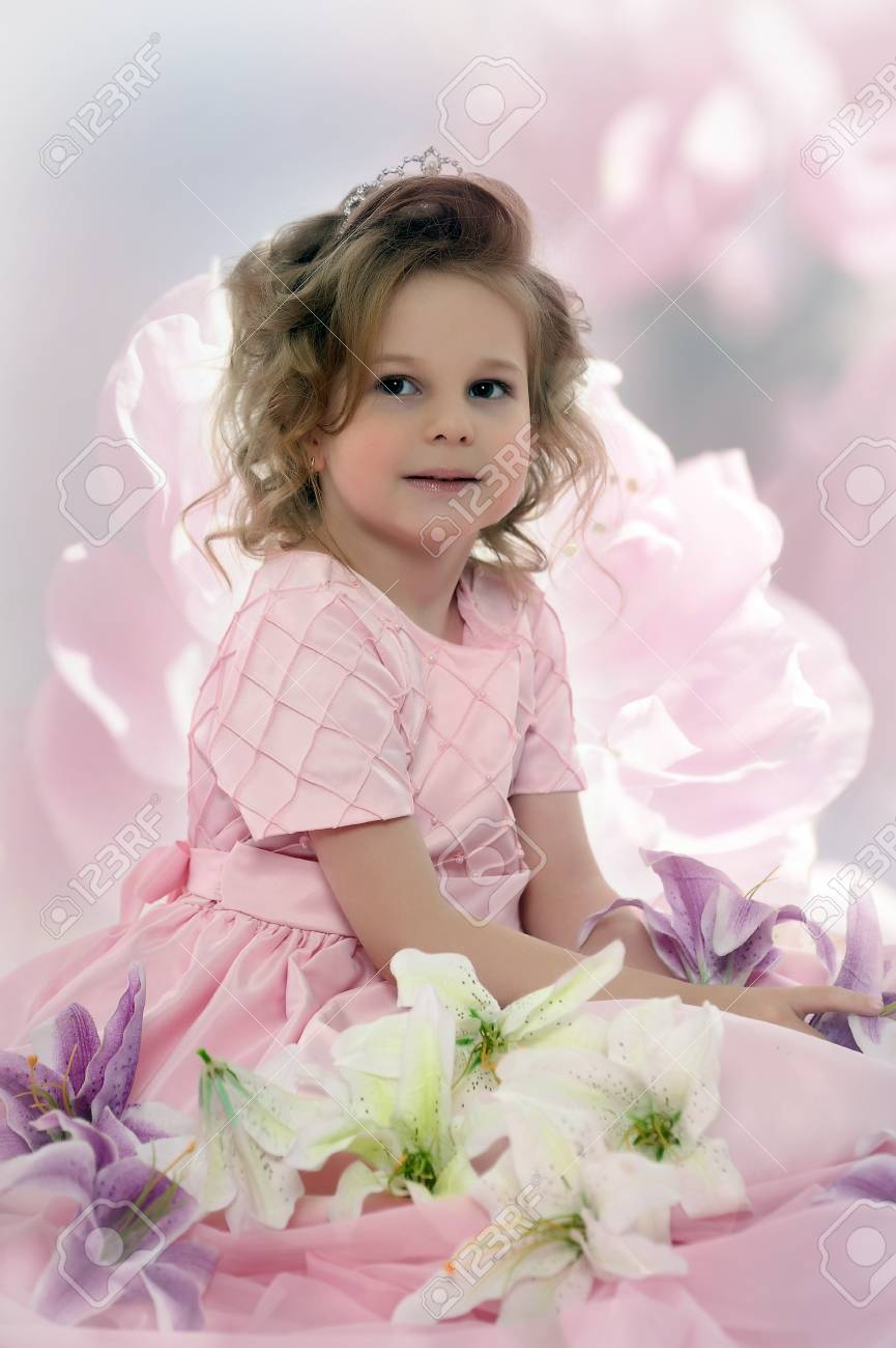 girl in a pink dress with flowers Stock Photo - 19000539