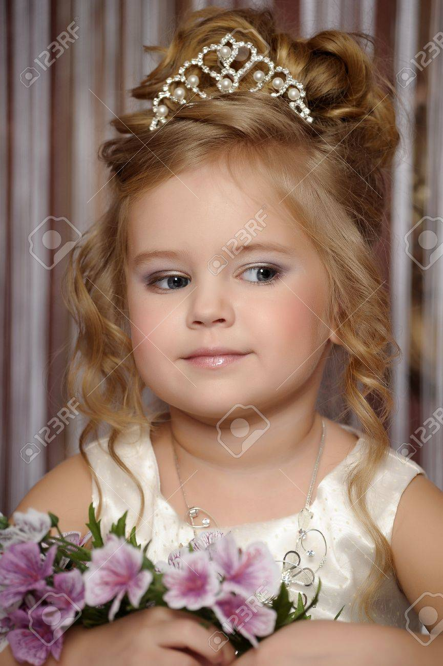 little princess in a white dress with a tiara on her head Stock Photo - 19428242