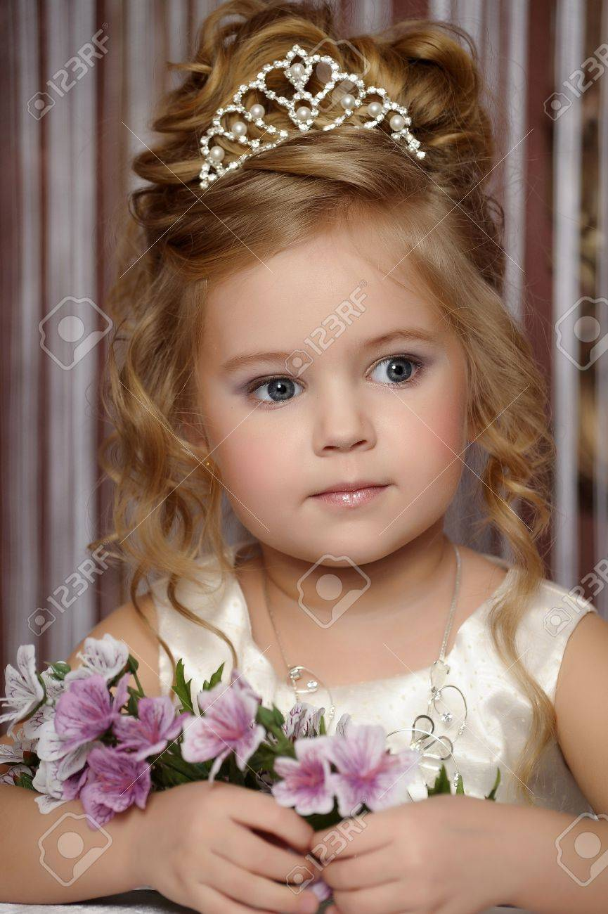 little princess in a white dress with a tiara on her head Stock Photo - 19428228