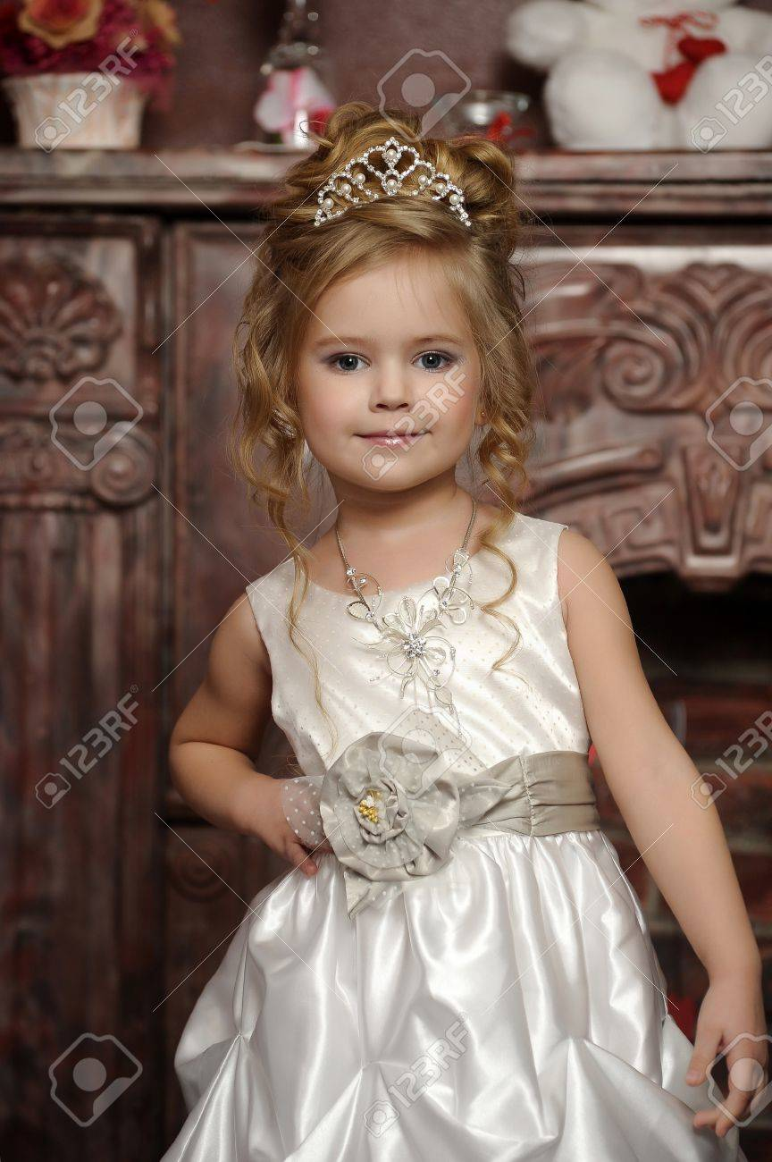 little princess in a white dress with a tiara on her head Stock Photo - 19428231