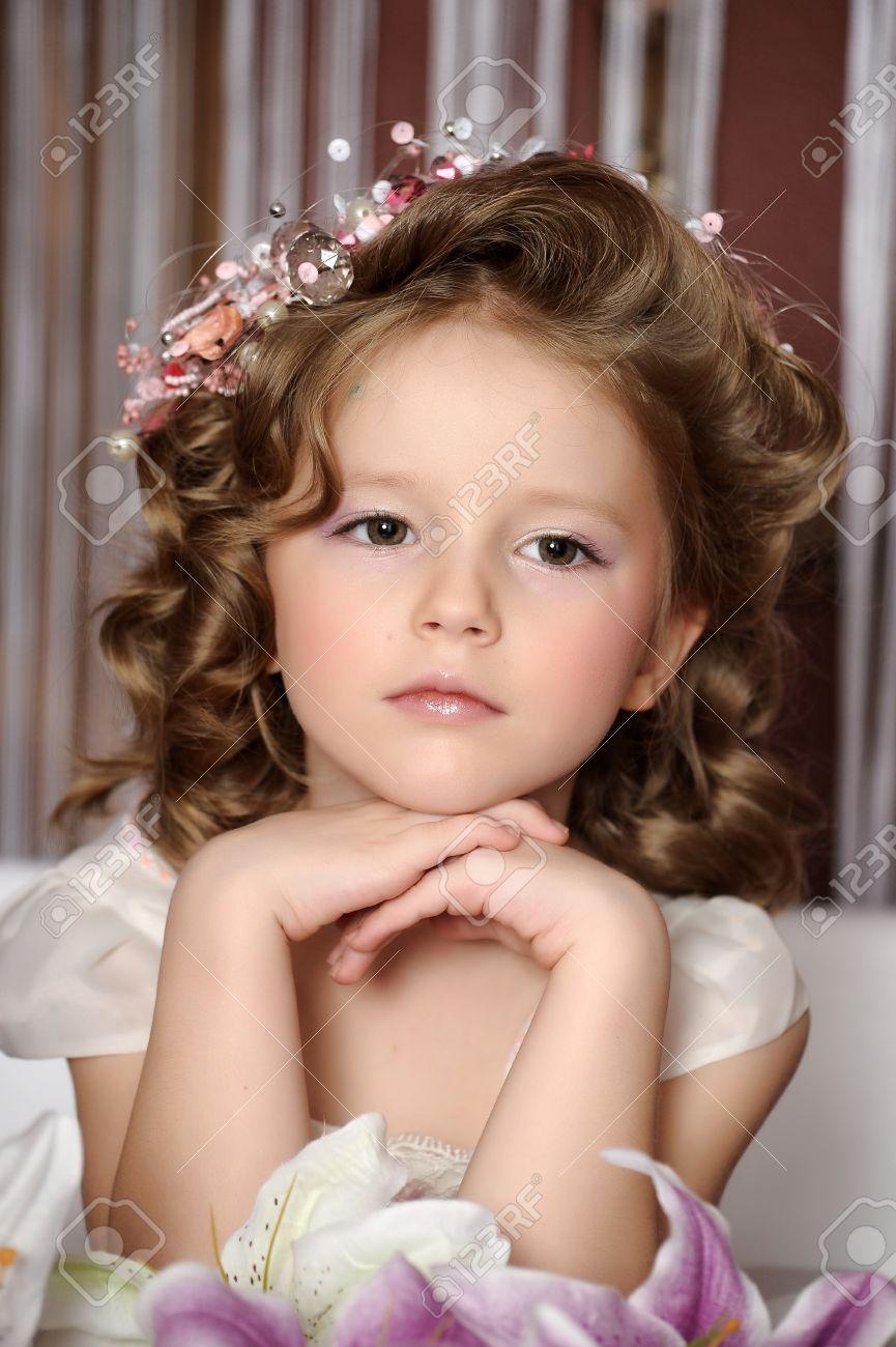 Beautiful little girl in wreath of pink flowers stock photo picture beautiful little girl in wreath of pink flowers stock photo 19582568 izmirmasajfo