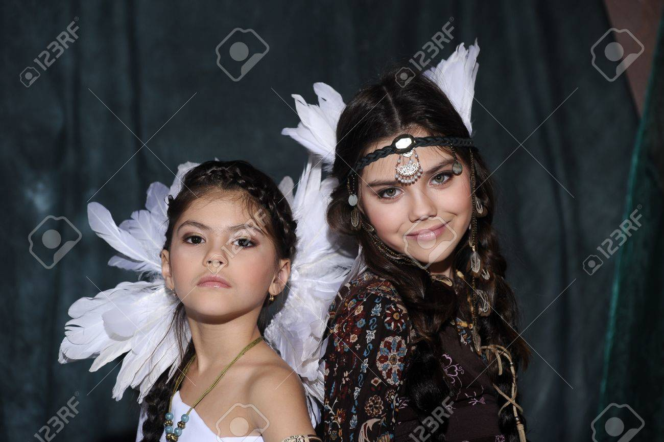 Two girls in suits of American Indians Stock Photo - 19902092