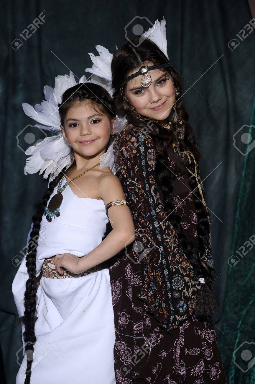 Two girls in suits of American Indians Stock Photo - 19902109