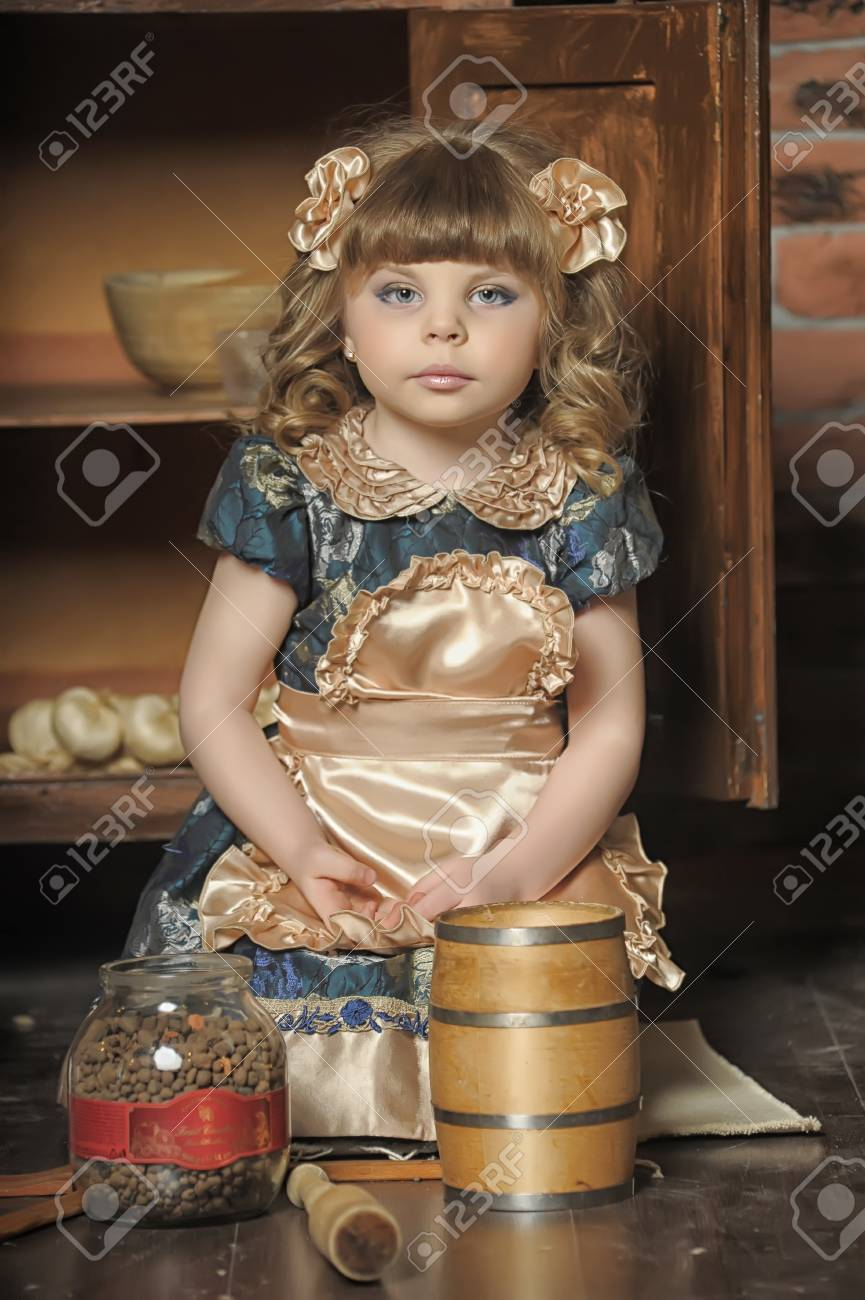 a little girl dressed in retro style on the old kitchen Stock Photo - 19204192
