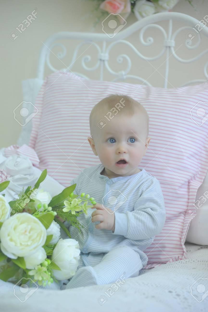 cute baby and white peonies Stock Photo - 19338024