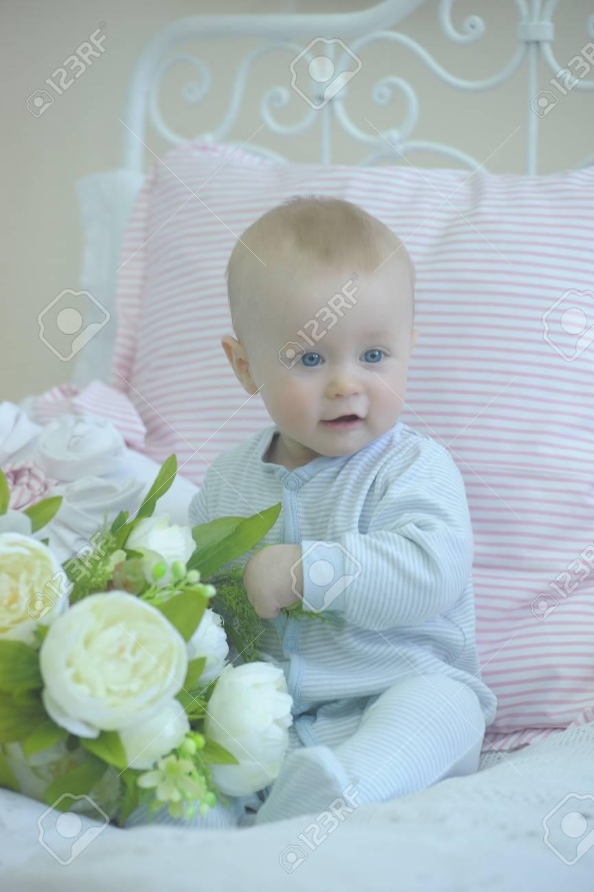 cute baby and white peonies Stock Photo - 19338020