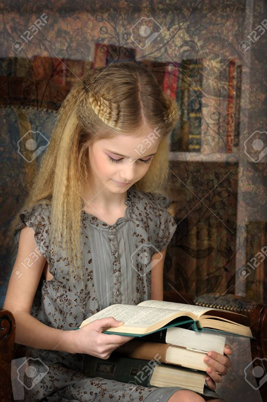girl holding a pile of books in the library Stock Photo - 19353665