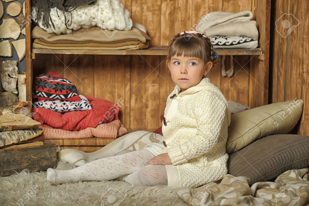 the little girl next to the wardrobe with warm clothes Stock Photo - 19338777