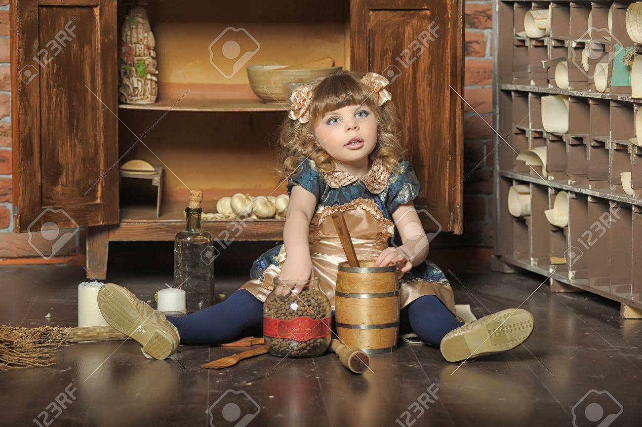 Old Kitchen A Little Girl Dressed In Retro Style On The Old Kitchen Stock