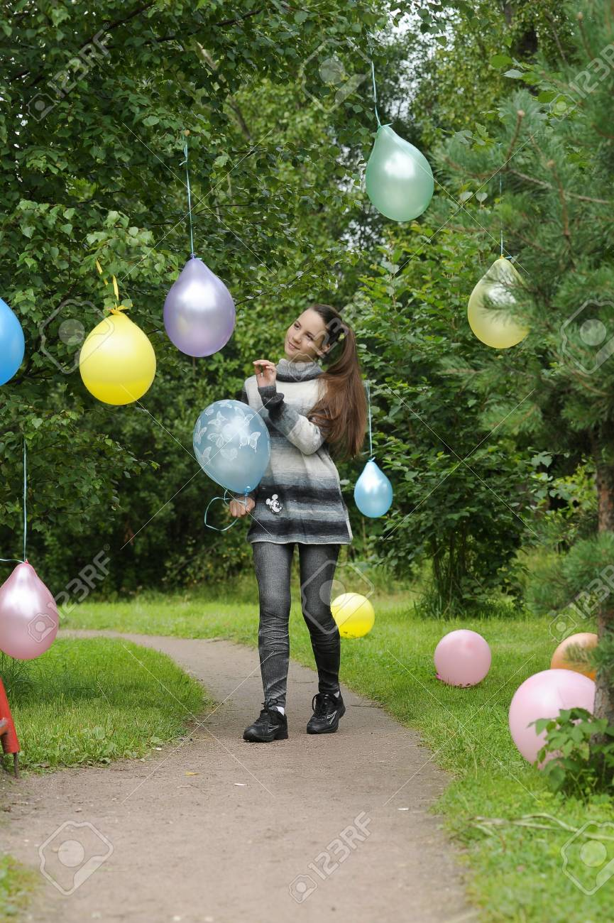Young girl with colorful latex balloons Stock Photo - 28394508