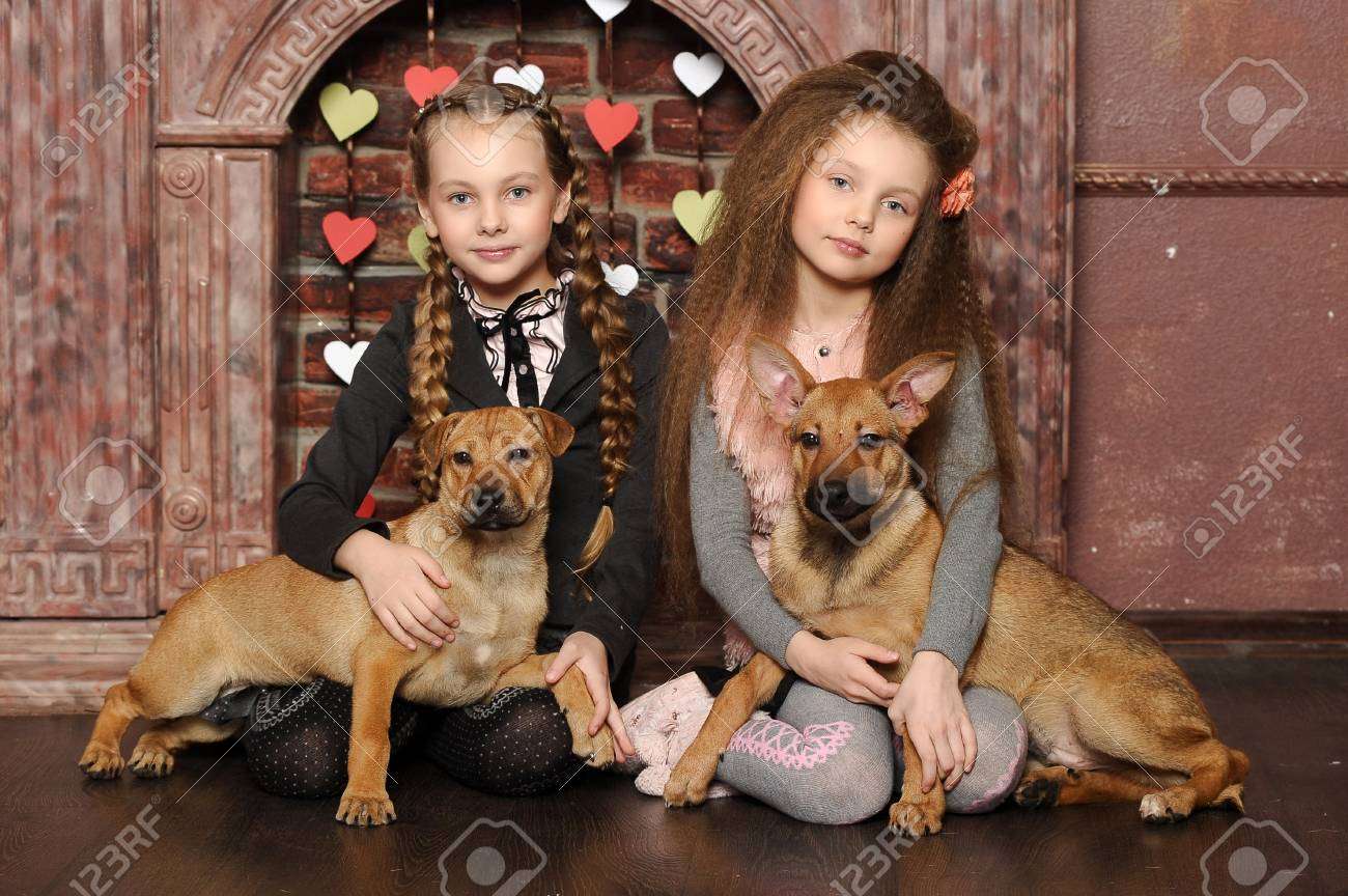 Two sister girls with puppies Stock Photo - 27608017
