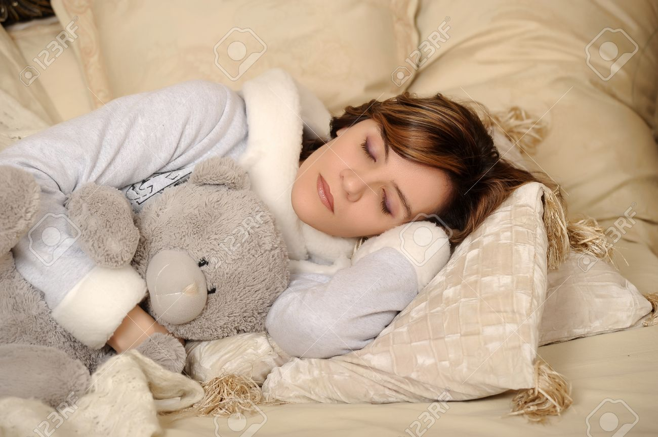 woman sleeping with teddy bear stock photo picture and royalty free