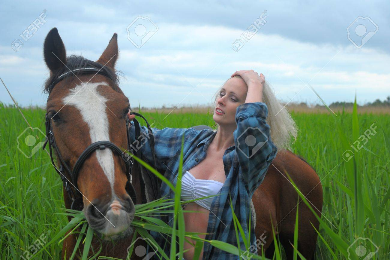 sexy blonde with a horse Stock Photo - 21732523