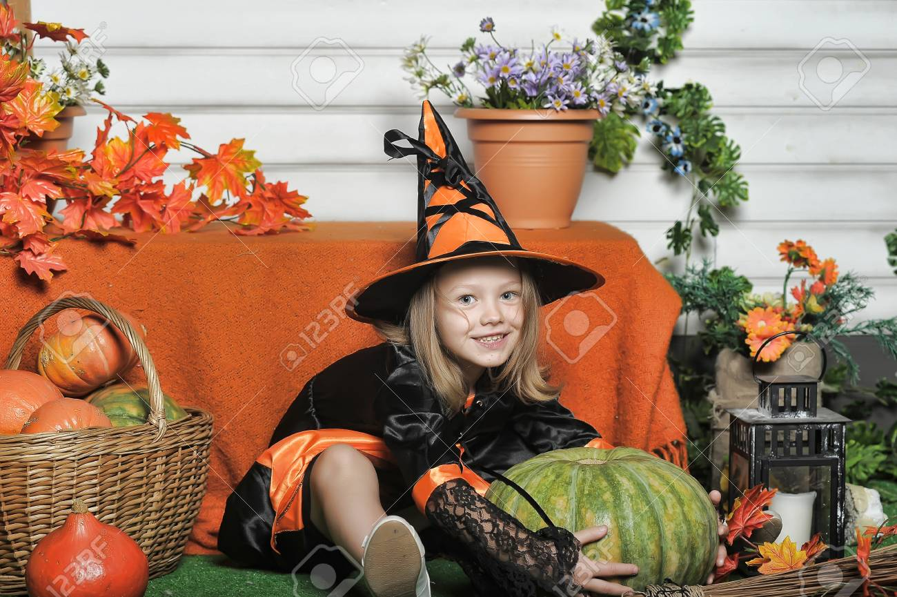 Charming little witch with hat Stock Photo - 22610815