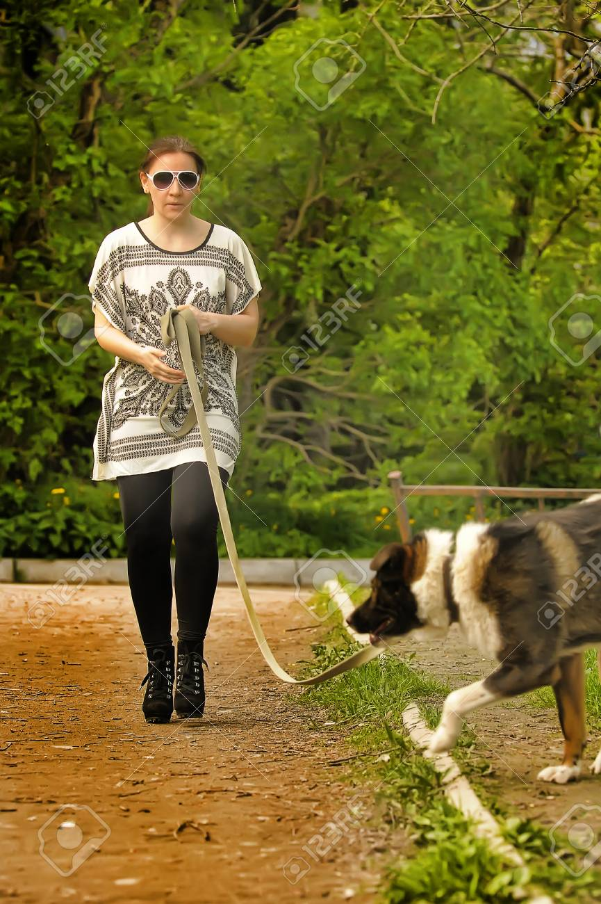 Woman with her dog Stock Photo - 28637111
