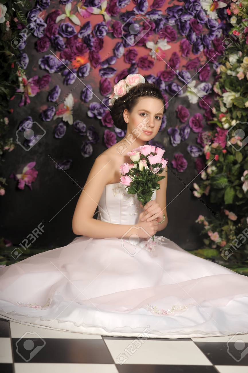 Young bride with flowers in her hair on a floral background Stock Photo - 30408586